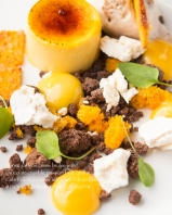 Honey saffron creme brûlée with chocolate crumble, passion fruit curd and meringue